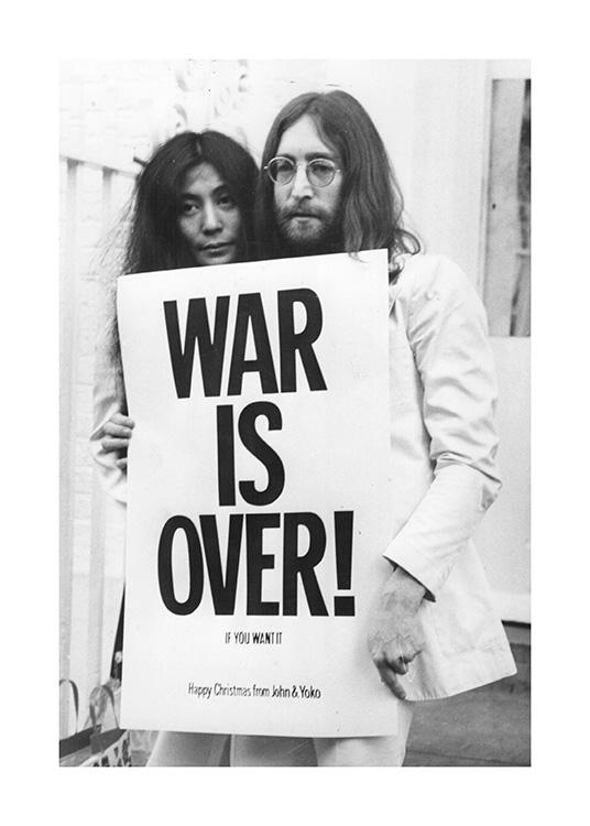 – Black and white photograph of John Lennon and Yoko Ono holding a protest sign
