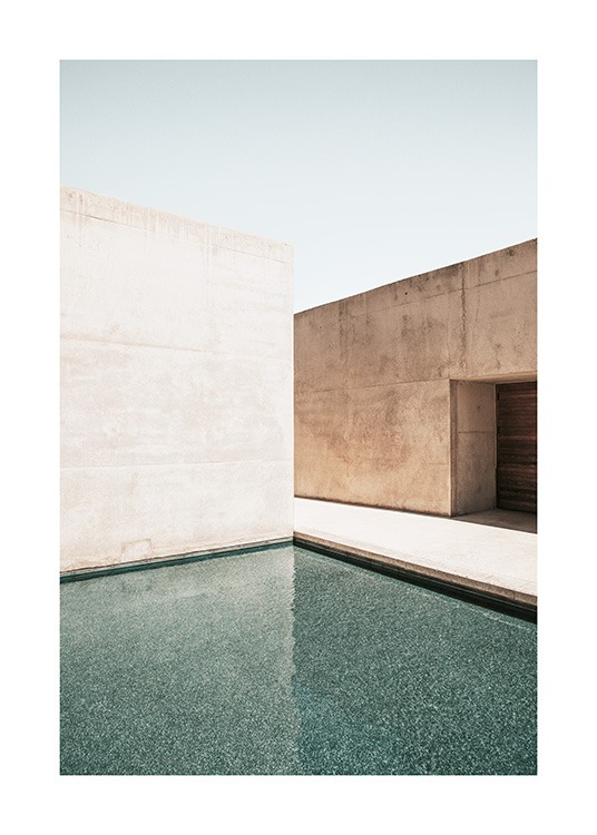 – Photograph of concrete buildings with a large pool in front