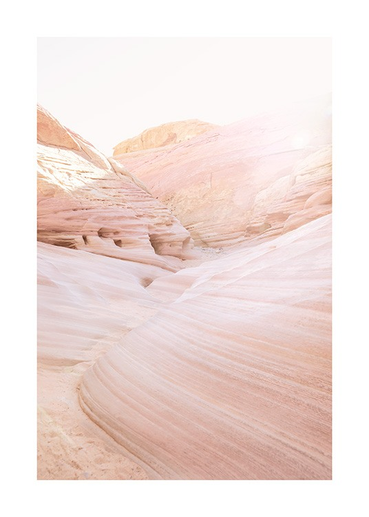 – Photograph of desert landscape with pink canyons and wave rocks
