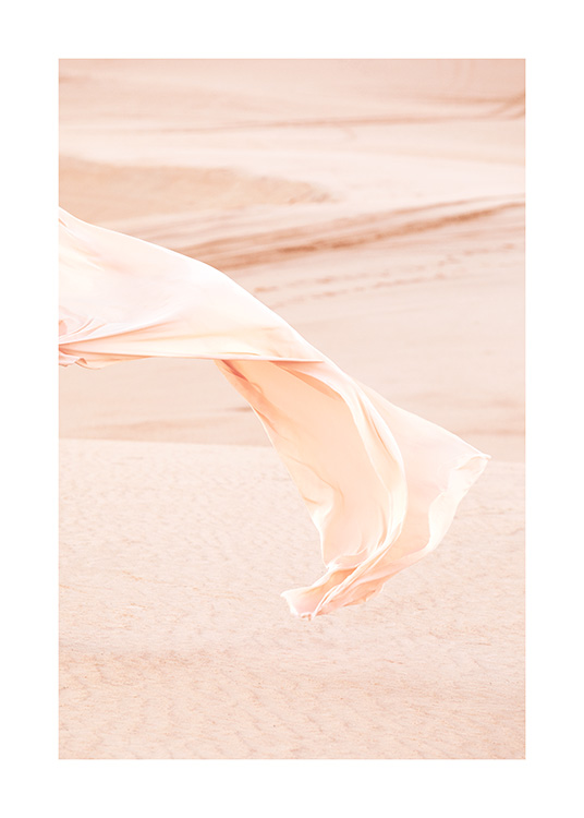 – Photograph of fabric flowing in the wind in desert landscape