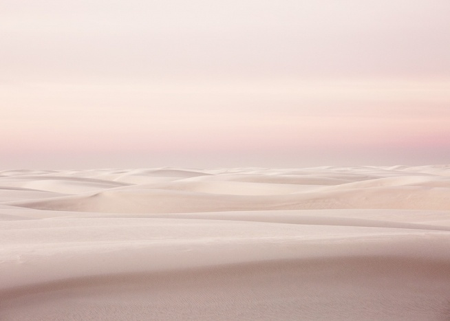 Photograph with pink sky behind white sand dunes