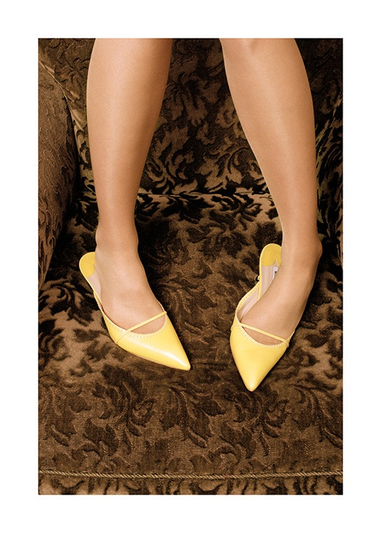 - Photograph of brown patterned couch with woman in yellow heels