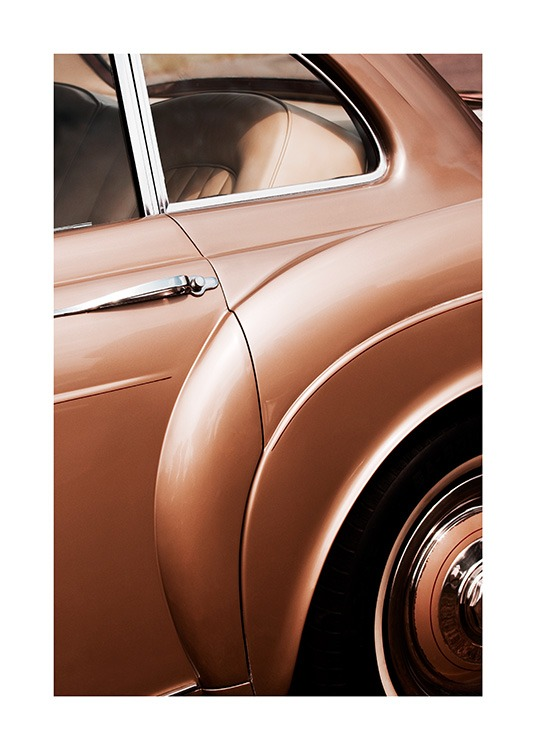 - Close up photograph of a vintage car in bronzed brown with silver details