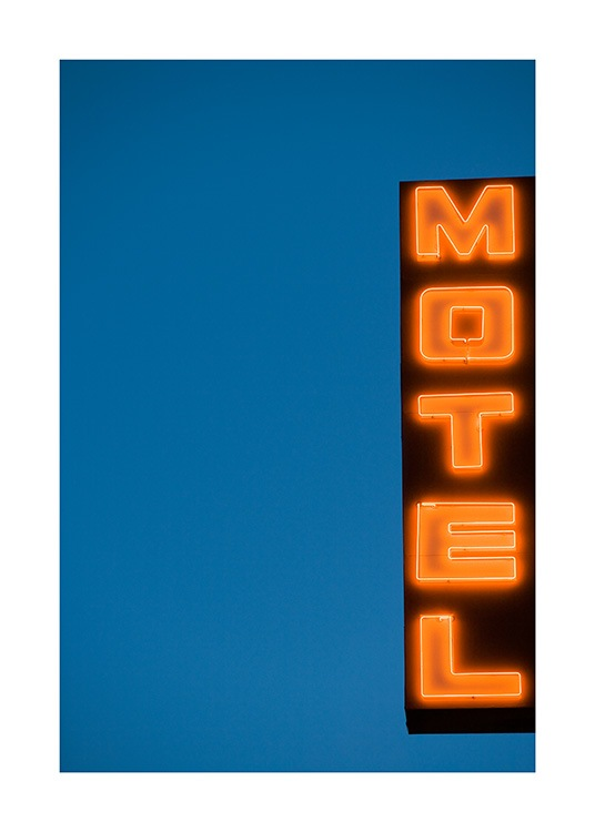 - Photograph of sign with neon lights and text Motel against a dark blue background