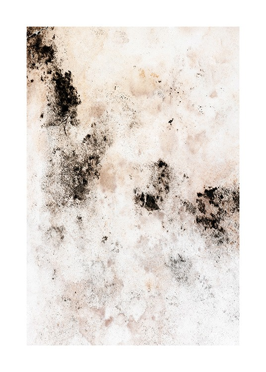 - Close up of beige and white wall with black spots and stains in abstract pattern