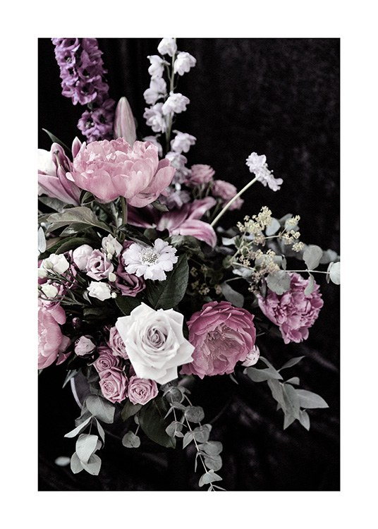 - Flower bouquet with white, pink and purple flowers and green leaves with a dark background