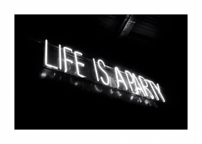 - Black and white photograph of neon sign with Life is a party