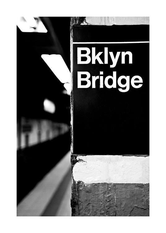 - Black and white photograph of subway sign in New York with Bklyn Bridge