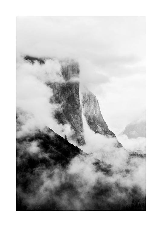 - Black and white photograph of El Capitan covered in fog, a rock formation in California