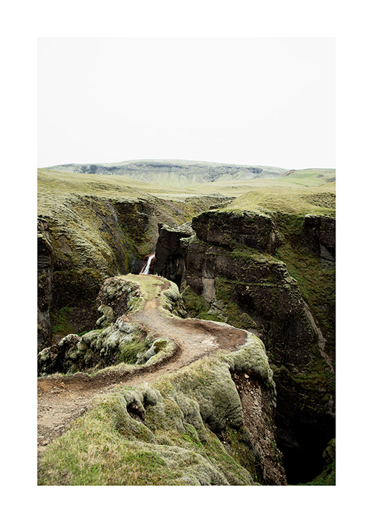 - Photograph of narrow path in green landscape on Iceland