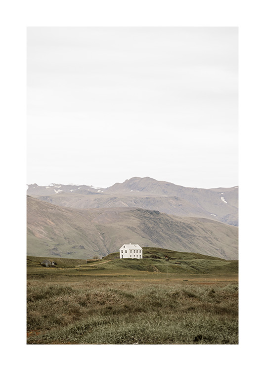 - Photograph of landscape on Iceland with lonely house in front of mountains