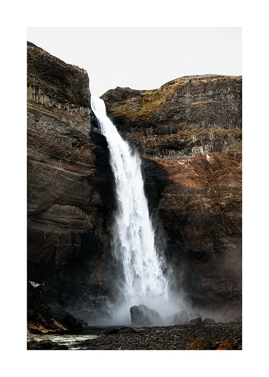- Photograph of waterfall Haifoss located in Iceland, surrounded by cliffs