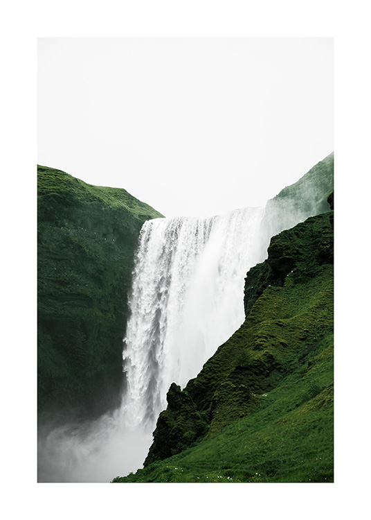 - Photograph of green landscape surrounding Skogafoss waterfall in Iceland