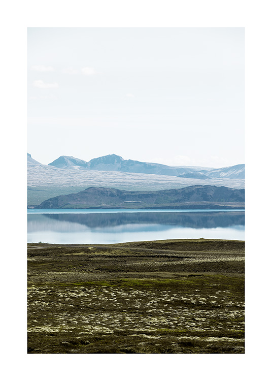 - Photograph of mountain landscape and mirror lake in Iceland
