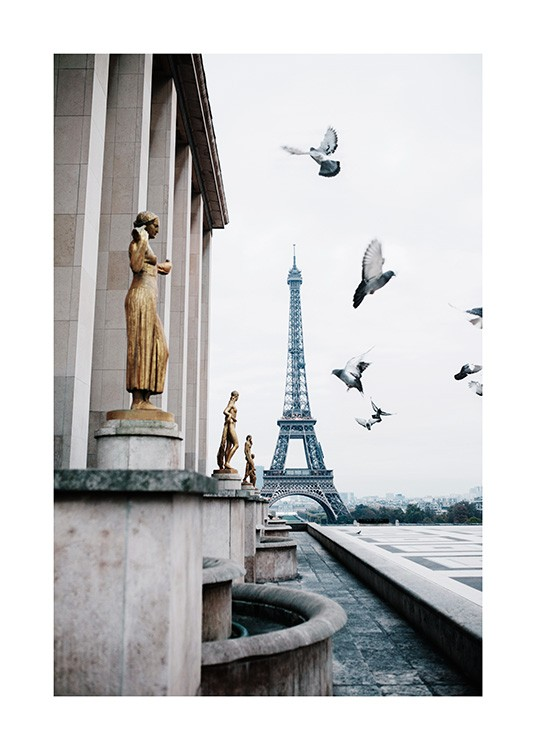 - Photograph from Paris with the Eiffel Tower behind flying pigeons and golden statues
