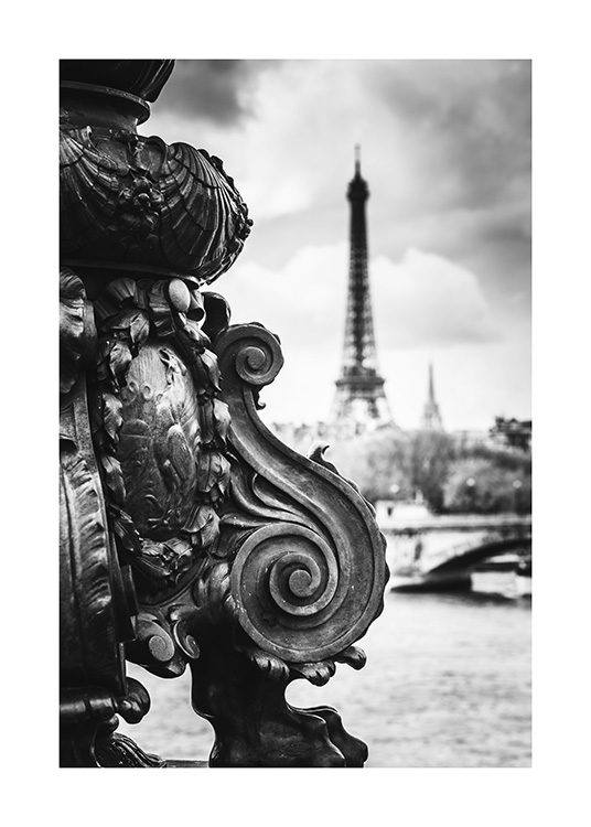 - Photograph of bridge details in front of the Eiffel Tower in black and white
