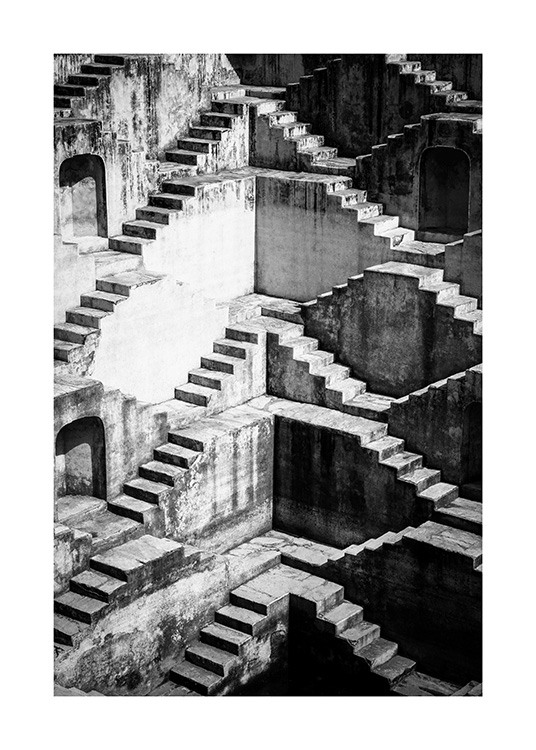 - Black and white photograph of walls with staircases next to them