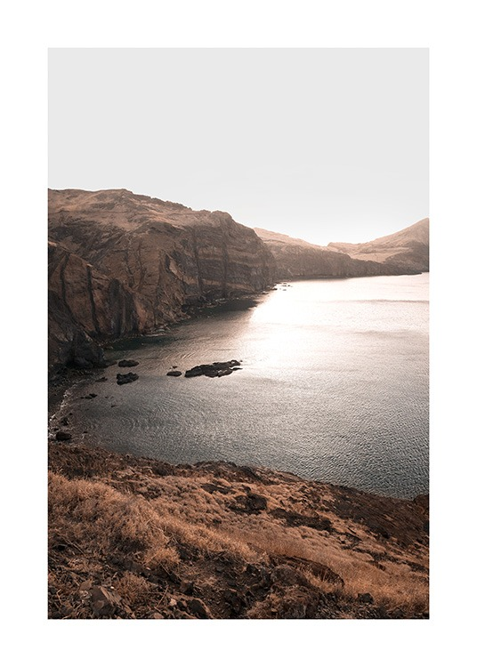 – Photograph of a mountain landscape and a lake in the sunset