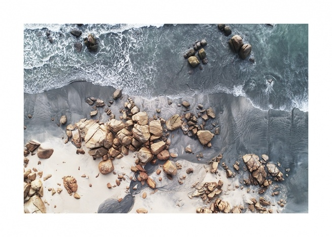 – Photograph from above of a seashore with rocks and boulders on the beach