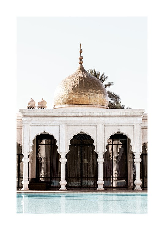 - Photograph of a white building with curved arches and pillars and a gold dome on the top
