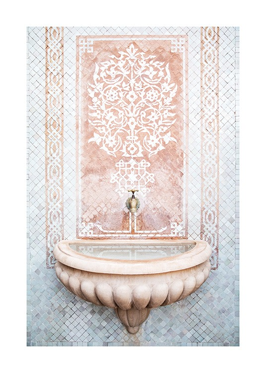 - Photograph of a mosaic wall in blue, pink and white behind a small fountain