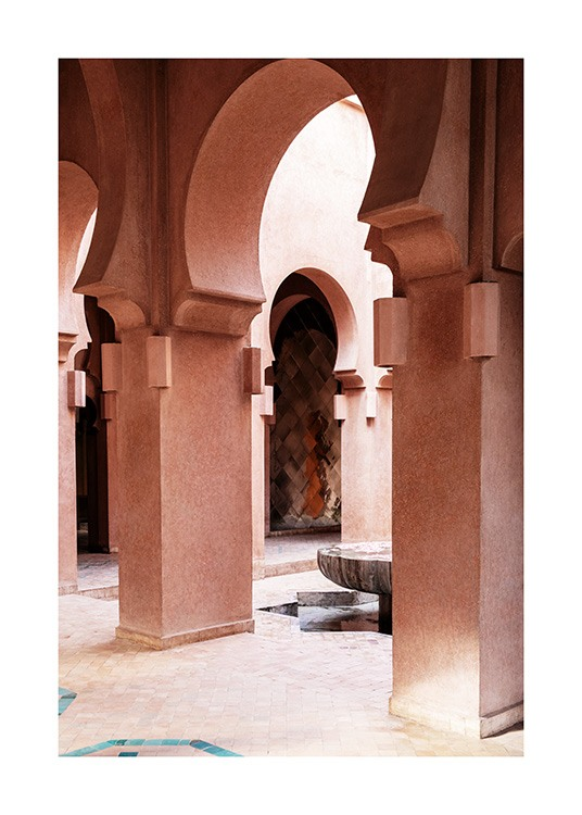 - Photograph of curved arches and pillars in a pink building