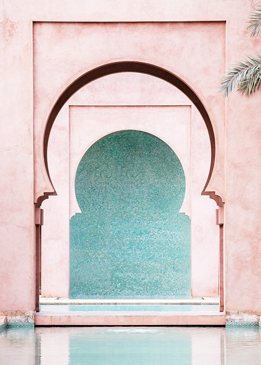 - Photograph of a blue wall in the middle of curved, pink arches