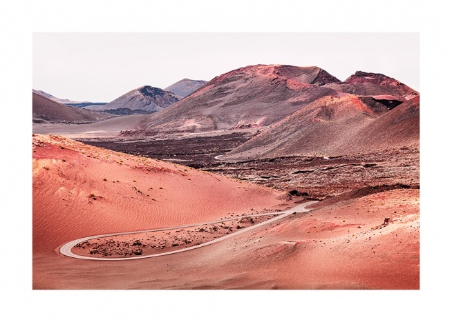 – Photograph of red sand in a volcanic landscape with mountains in the background