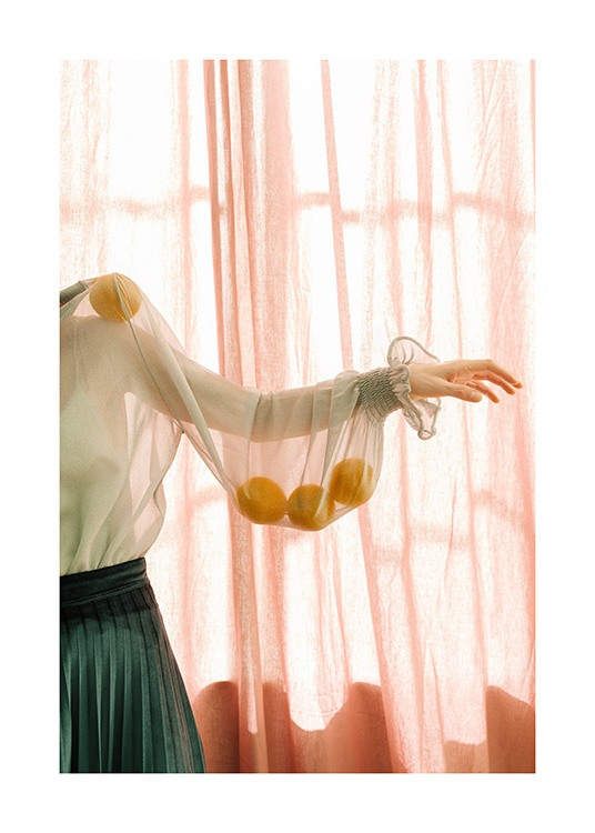 – Photograph of a woman with lemons in the sleeve of a sheer blouse