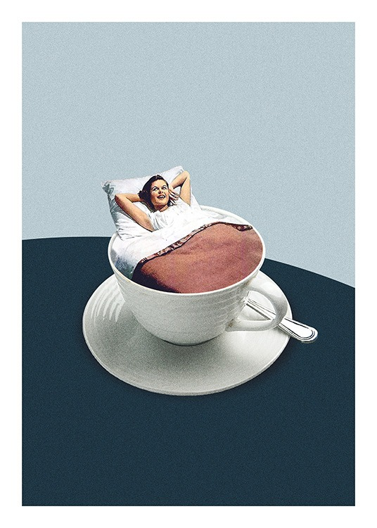 – Photograph of a woman in a coffee cup covered by a duvet