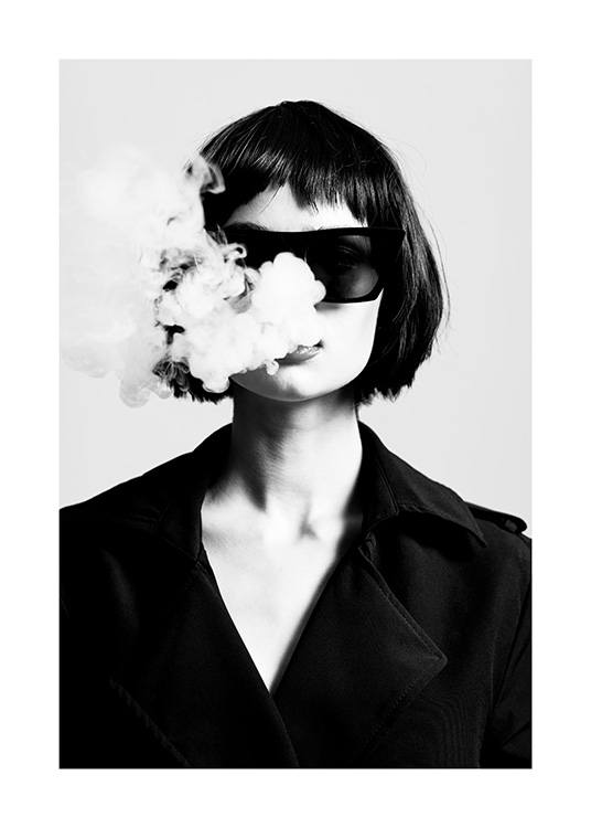 – Black and white photograph of a woman wearing sunglasses and a jacket with smoke coming out of her mouth