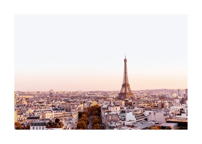 – Photograph from Paris, with buildings and the Eiffel Tower at dawn