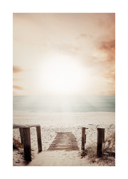 – Photograph of a beach at sunset with a wooden staircase leading down to the beach
