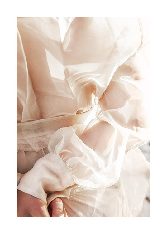 – Photograph of a blouse in beige with sheer arms