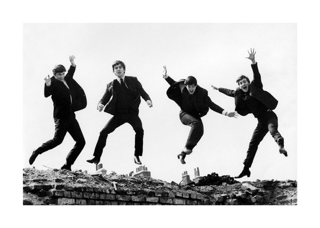 – Black and white photograph of the members of the Beatles jumping in the air