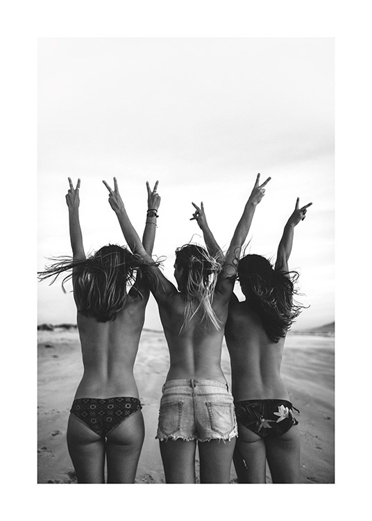 – Black and white photograph of three girls wearing shorts and bikini bottoms, doing the v sign with their arms stretched up