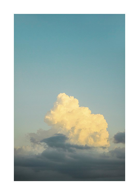 – Photograph of a bright blue sky with yellow clouds in front of it