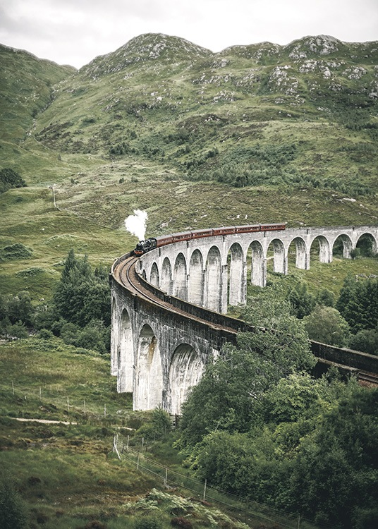 – Photograph of the Glenfinnan Viaduct and a train surrounded by a green landscape