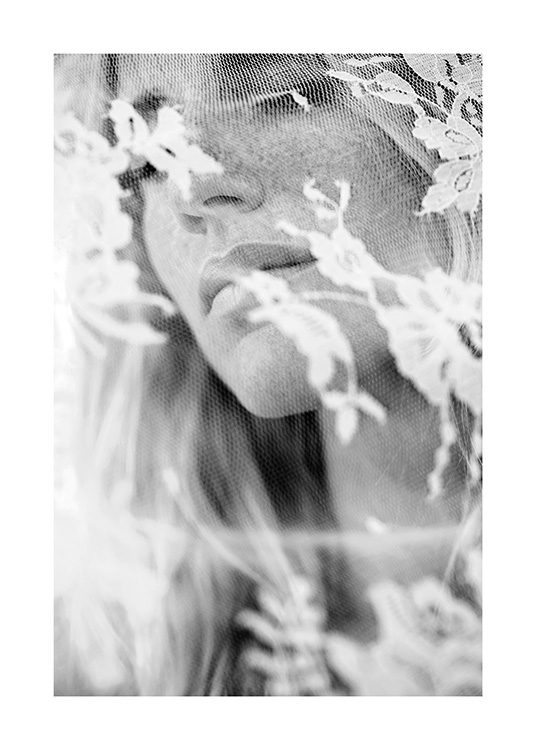 – Black and white photograph of lace covering a woman's face