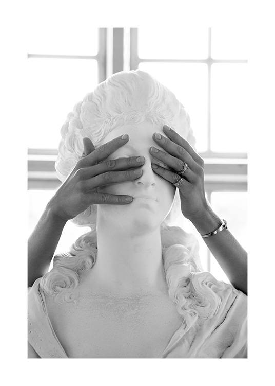 – Black and white photograph of a marble statue, with a woman covering its eyes with her hands