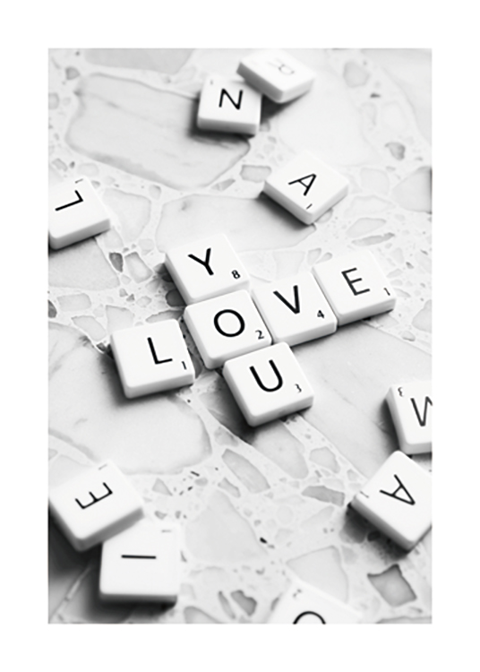 – Photograph of scrabble letters on a terrazzo background, forming the words Love You