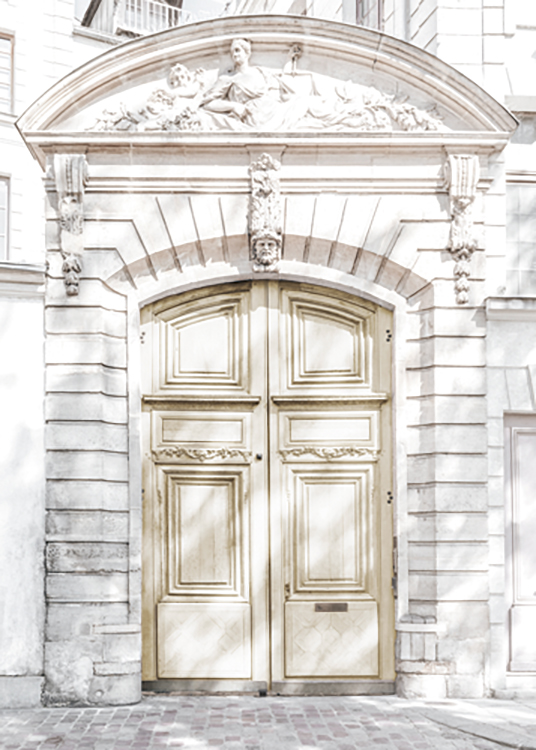 – Photograph of a light yellow door in a marble building with antique carvings