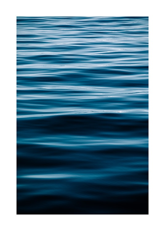 - Photograph of a blue ocean with still waves flowing