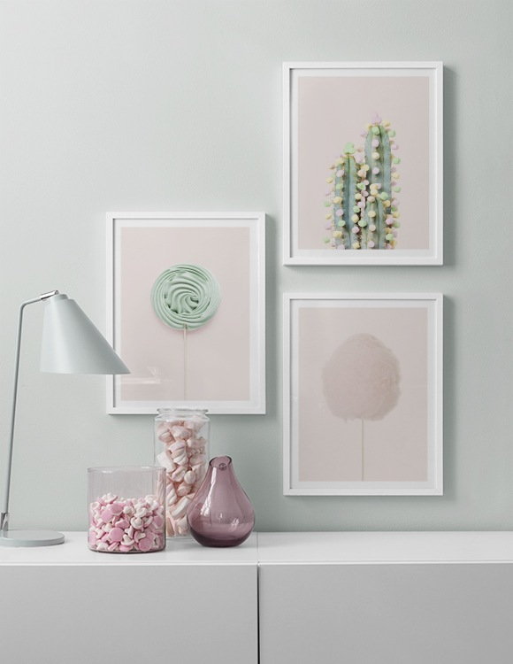Interior with light green wall and pink posters