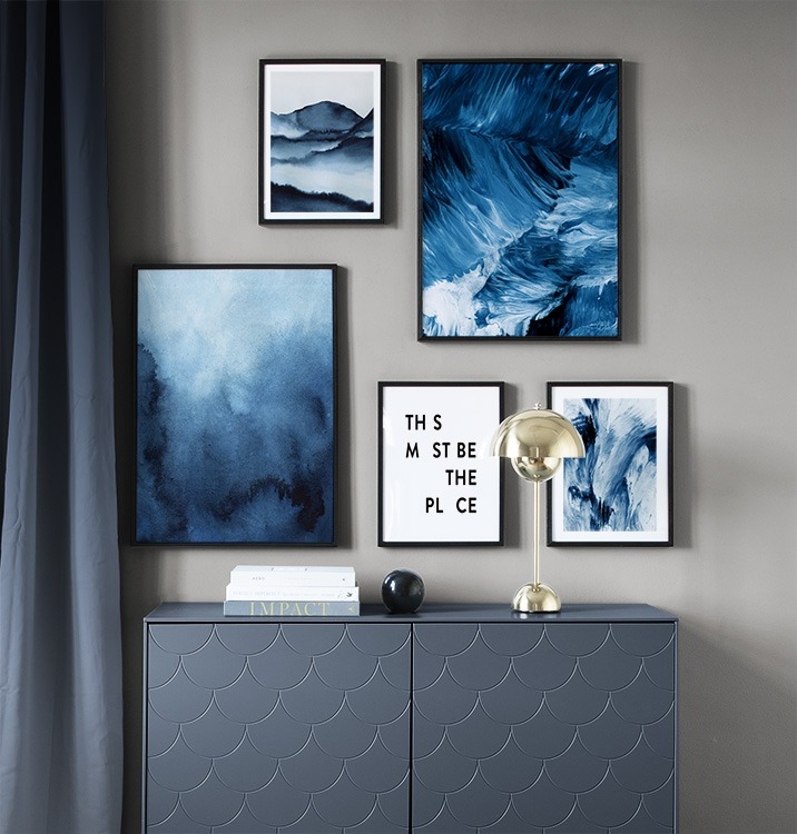Stylish gallery wall with blue abstract art
