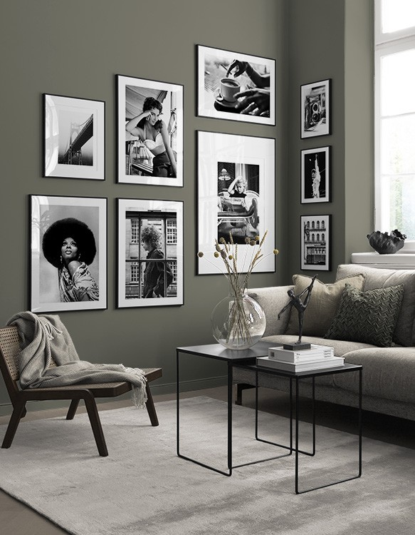 Black-and-white photos in green living room