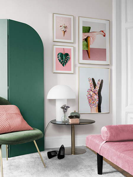 Four posters with photographs on a wall. Photo posters from Desenio.