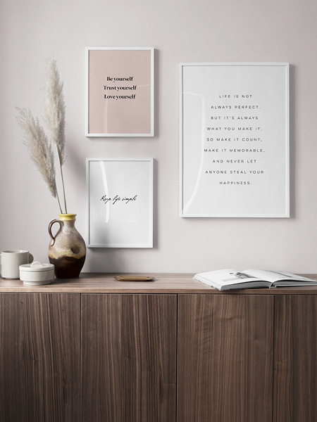 Modern typography posters. Three prints with quotes and sayings framed on a wall.